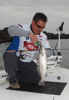 Speckled trout are caught along Masonboro Inlet's rock jetties when the falling tide pulls baitfish and shrimp toward the ocean.