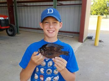 Elijah Crabtree, a 12-year-old angler from Bladenboro, poses with the new North Carolina state record spotted sunfish.