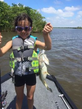 Elizabeth Ward holds the first bass she caught on her own. It hit one of her father's CW Custom Lures spinnerbaits.