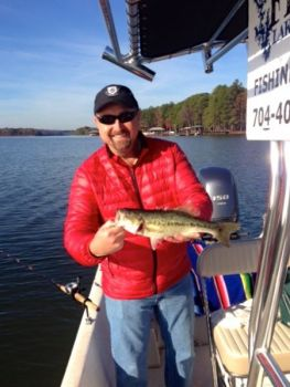 Guide Bob Curan targets spotted bass around creek mouths on Lake Norman as October progresses.
