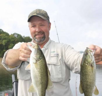 Guide Ronnie Parris targets smallmouth bass on deep, rocky points at Fontana Lake this month.