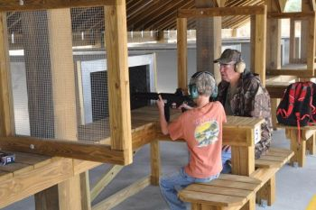 The first shots at Holly Shelter Range were fired by 11-year-old Cooper Brown of Burgaw, who was brought by his grandfather, Pete Brown, to see the grand opening.