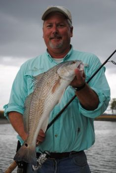 Capt. Rob Bennett finds plenty of quality redfish in the deeper holes in tiny creeks throughout the cold weather months.