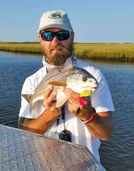 Spinnerbaits are great lures to fool redfish in the stained waters of coastal rivers.