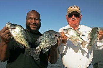 Long-line trolling produced these nice Lake Wylie crappie for guide Jerry Neeley (right) and former Dallas Cowboy defensive end Marcus Spears.
