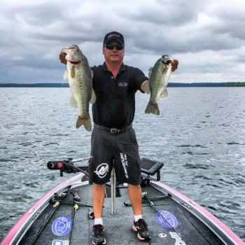 Schooling bass hang around main-channel drops and ledges during the summer, where anglers can target them.