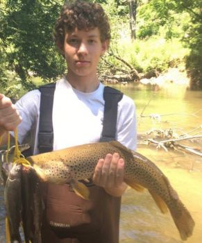 While fishing in Ashe County with his brother-in-law, Nich Krayniewski caught this big brown trout.