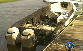 Three people were injured in North Carolina Friday after 28 gallons of fuel were mistakenly pumped into this boat's rod holder, which prompted an explosion when a battery was disconnected, according to authorities.