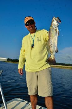 The author caught this big summer speckled trout on a MirrOlure Top Dog, a popular topwater lure, shortly after dawn.