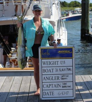 Carolina Rhodes shows off one of the many dolphin caught so far during this year's Big Rock Blue Marlin Tournament.