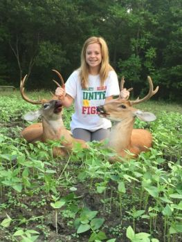 Olivia Pace killed these two deer in August of 2015, capitalizing on the opportunity to kill a buck in velvet (and one without).