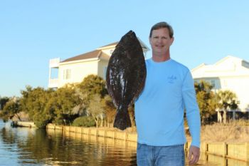 Saltwater ponds throughout the Carolinas are great places to catch flounder.
