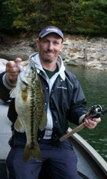 Guide Rob McComas catches big spotted bass on Lake Jocassee during December, looking for them in deeper creek and river channels.