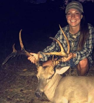 Carly Rhea Cofield of Lee County poses with a buck she hopes will make the next list of all-time antler records for South Carolina.
