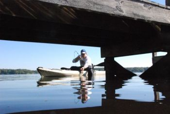 "A kayak is a great platform for ""shooting"" a tiny jig back up under a dock during prime crappie fishing times."