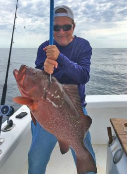 Robert Dean poses with the new N.C. state record red grouper, which he caught while fishing aboard the Cheerio Lady out of Carolina Beach.