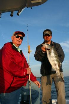 The author (left) caught this nice Lake Murray striper fishing with guide Brad Taylor.