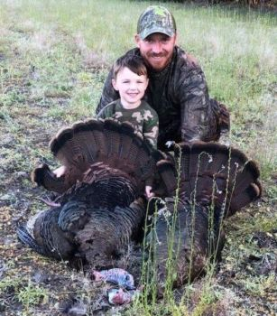 Johnny Pippin (right) called these two jakes into range for his son Finn, who killed the two birds with a single shot.