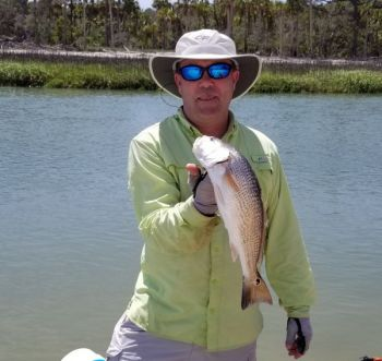 Dalton Reames shows off a slot-sized redfish caught this past weekend in a lowcountry creek.