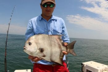 Capt. Robert McCarley shows off a typical spadefish caught from a nearshore reef.