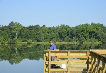 An angler fishing from the new pier at Lake Edgar Brown in Barnwell, S.C.
