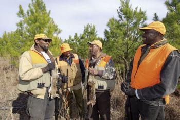 Terrial White, Larry Royal, Roland Boney Jr. and Joe Kelly enjoy a rabbit hunt in Duplin County.