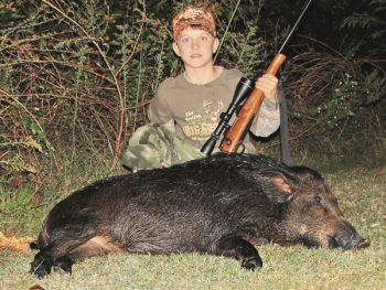 Jared Raynor has killed close to 30 wild hogs on his grandfather's farm in the Neuse River lowlands in Johnston County.