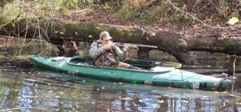 Tommy Price uses a kayak to float local rivers when drought conditions dry up other duck holes.