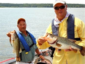 Mike Dinterman (left) and Robert Williams Jr. finished second and had the big fish at the July 28 Piedmont Bass Classic event on Jordan Lake.