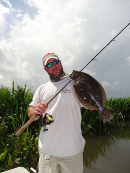 Clayton Crawford caught this hefty flounder while trolling a soft-plastic lure.