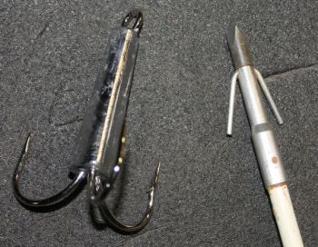 A big treble snatch hook and a special arrow point are common accessories for gator hunters.