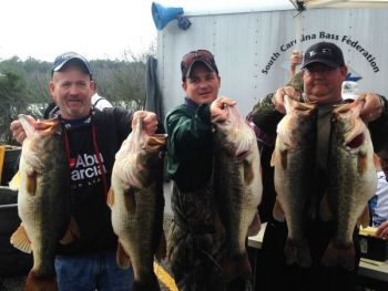 Brian Tyler (left) needed help showing off his amazing five-fish limit of bass weighing 42.3 pounds that came from the Cooper River in an SC BASS Federation tournament on Saturday.