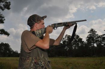 Tanner Jackson lets fly at a passing dove near the airstrip on Suggs Mill Pond Game Lands on a permit-only hunt.