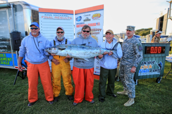 Kent Raynor, Scott Pelletier, Capt. Jodie Gay, Timmy Parker, and Sgt Trevor Hanlon pose with the record king mackerel caught by Pelletier during the Championship for the North Carolina National Guard Cape Lookout Shootout Series presented by Yamaha. The fish weighed more than 68 pounds.