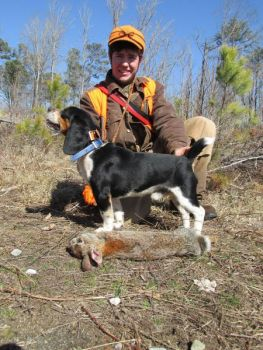GPS tracking collars allow hunters like Eric Braselton to keep up with the movements of beagles on a rabbit hunt.