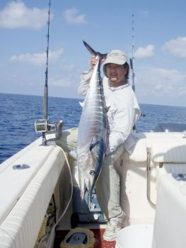 Anthony Ng shows off the kind of huge wahoo that show up in blue-water hotspots south and east of Frying Pan Shoals.