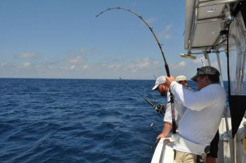 Greg Dreibelbois of Gastonia battles a large amberjack fishing offshore with Capt. Kevin Sneed.