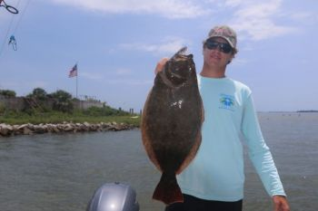 Capt. Addison Rupert of Lowcountry Outdoor Adventures holds a flounder that would have no problem meeting South Carolina's new flounder regulations.
