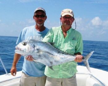 Jerry Crute (left) and Randy Horne show off a big African pompano caught off the tip of Frying Pan Shoals.