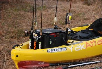 Typical rod storage options on a kayak require placing rods vertically behind the angler, often necessitating the skill to cast sidearm accurately.