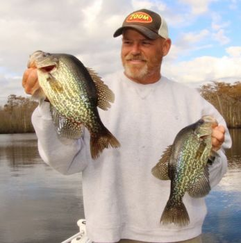 Capt. Todd Vick shows off two crappie from a recent trip on the Waccamaw River.