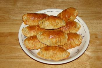 After their surfaces are brushed with egg wash, Empanadas should bake until golden brown.