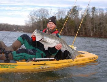 The author shows off a 25-pound Lake Hartwell striper, his best-ever from a kayak, on a cold, January day.