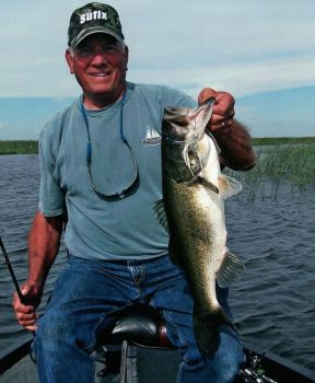 Steve Porter, who created the Super Sally, holds a hawg he caught with one recently on Florida's Lake Okeechobee.