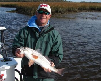 Guide Jeff Wolfe looks for winter redfish in the shallow, warmer bays east of the Cape Fear River upstream from Bald Head Island.