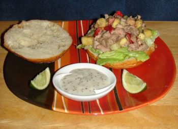 A tuna salad, cooked with jerk seasoning and garnished with fruit, makes for a great spring meal.