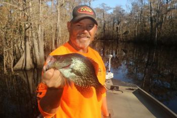 Todd Vick poses with a typical wintertime river crappie.