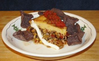 Blue corn tortilla chips and sour cream accent a tamale pie.