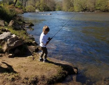 A young angler works a section of the Tuckasegee River in Jackson County, one of North Carolina's most-popular delayed-harvest trout streams.
