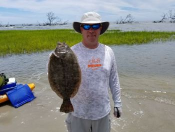 Dalton Reames shows off a keeper flounder caught at high tide on what many anglers consider to be a ruined creek.